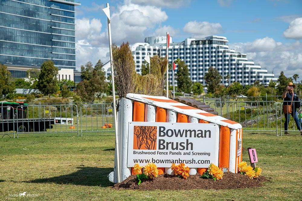 Bowman Brush branded horse jump in an equestrian show